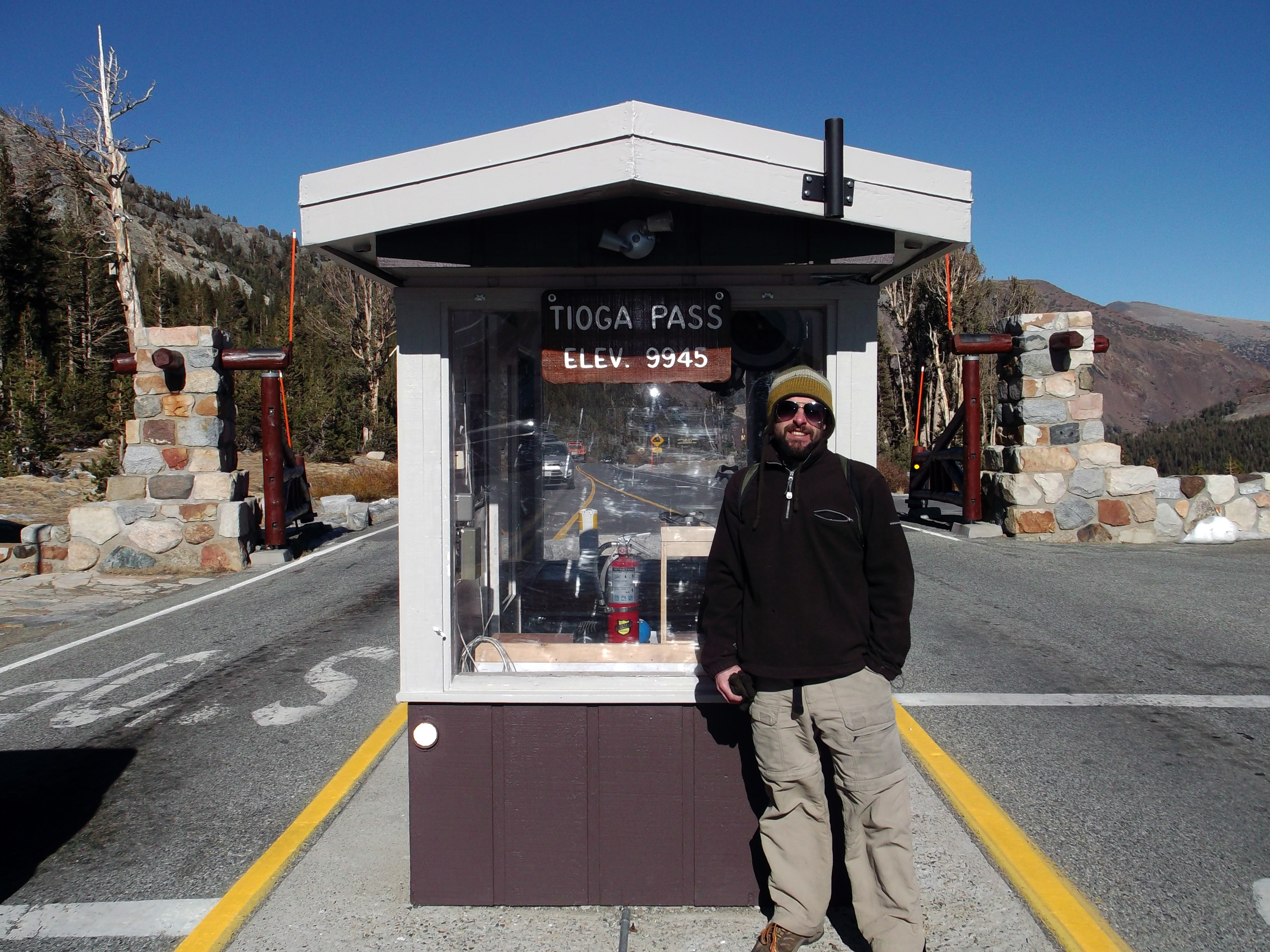 Your friendly neighborhood wordsmith adorns the Tioga Pass entrance station to Yosemite, a place where normally no man can stand between November and May. But then this ain't your parents' world anymore, is it?  (photo by S. McCarthy)