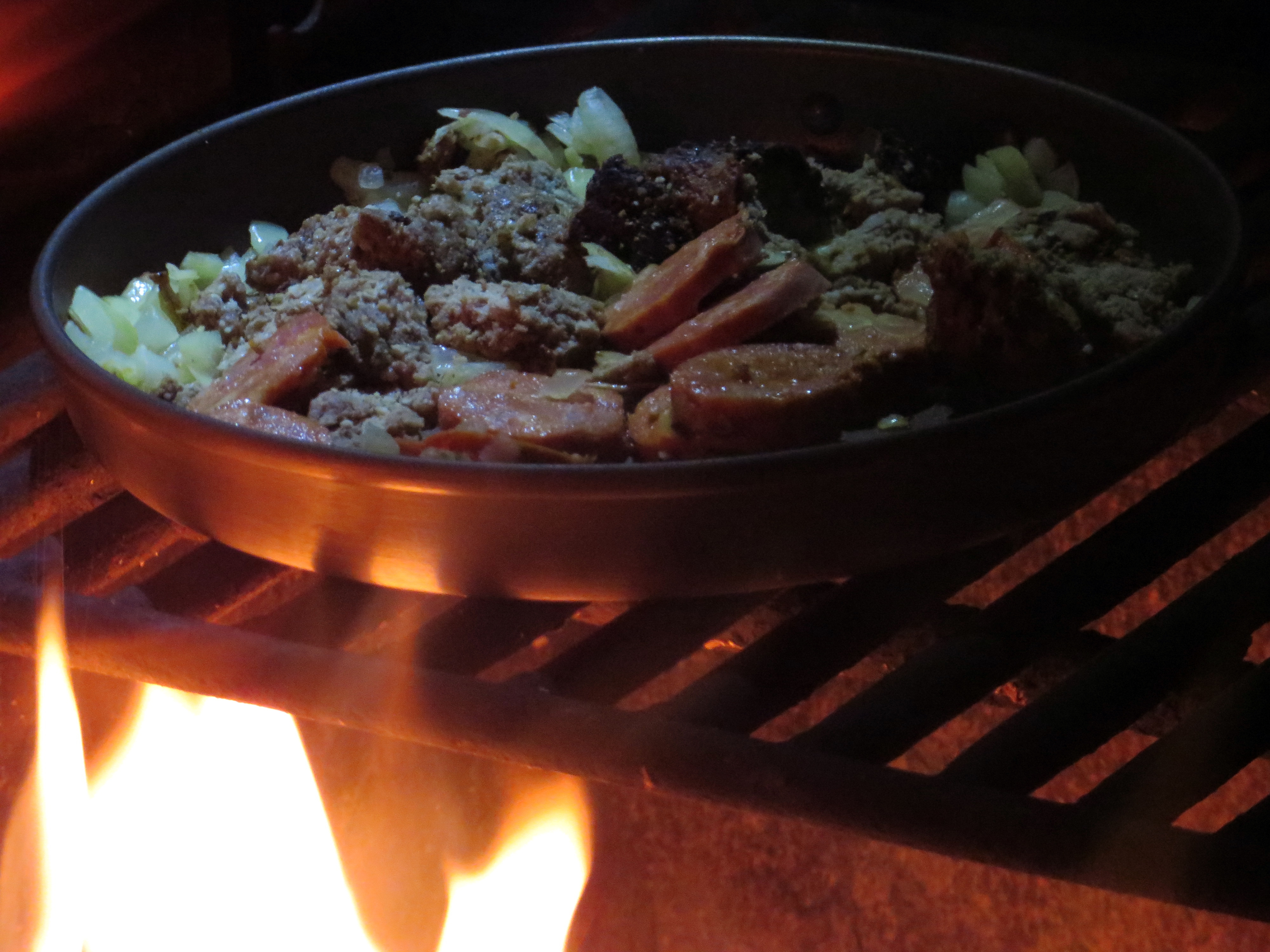 The seasoned outdoorsman knows that everything tastes better cooked over the live flame of a campfire. (photo by D. Speredelozzi)