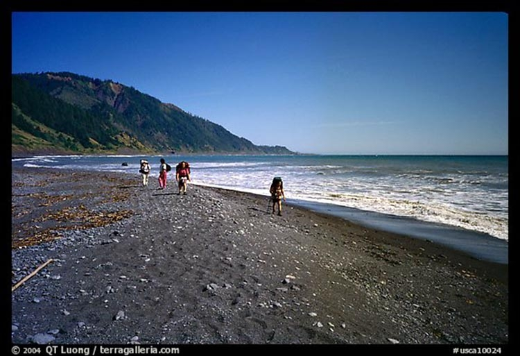 Every step taken on the soft, deep black sand beaches of the Kings Range is as two to three steps taken on solid ground, but only in terms of physical toll taken, not mileage covered.  (photo by QT Luong)