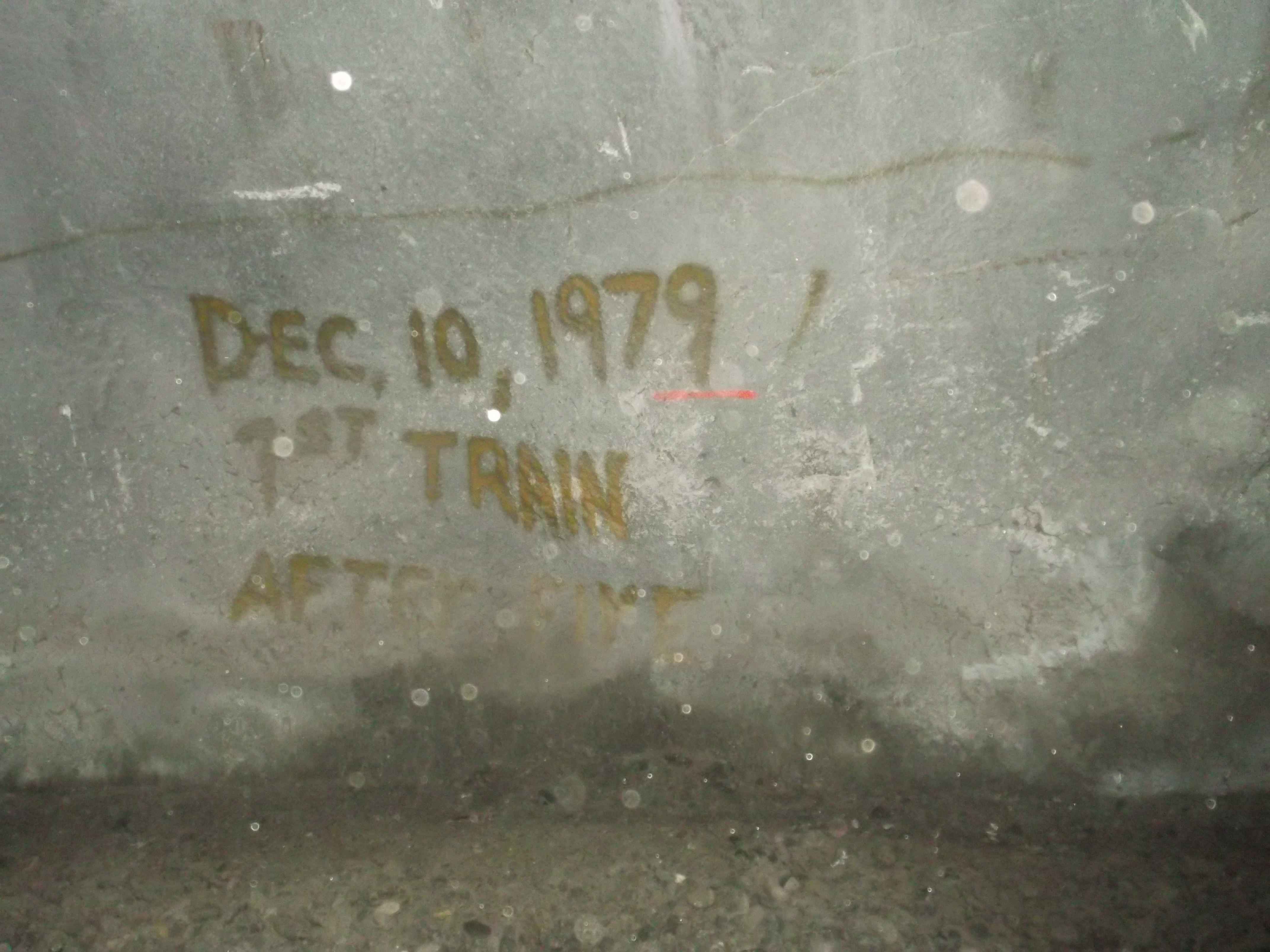 A crude note, hastily scribbled onto the wall of the tunnel, commemorates its re-opening after the fire of 1978. (photo by D. Speredelozzi)