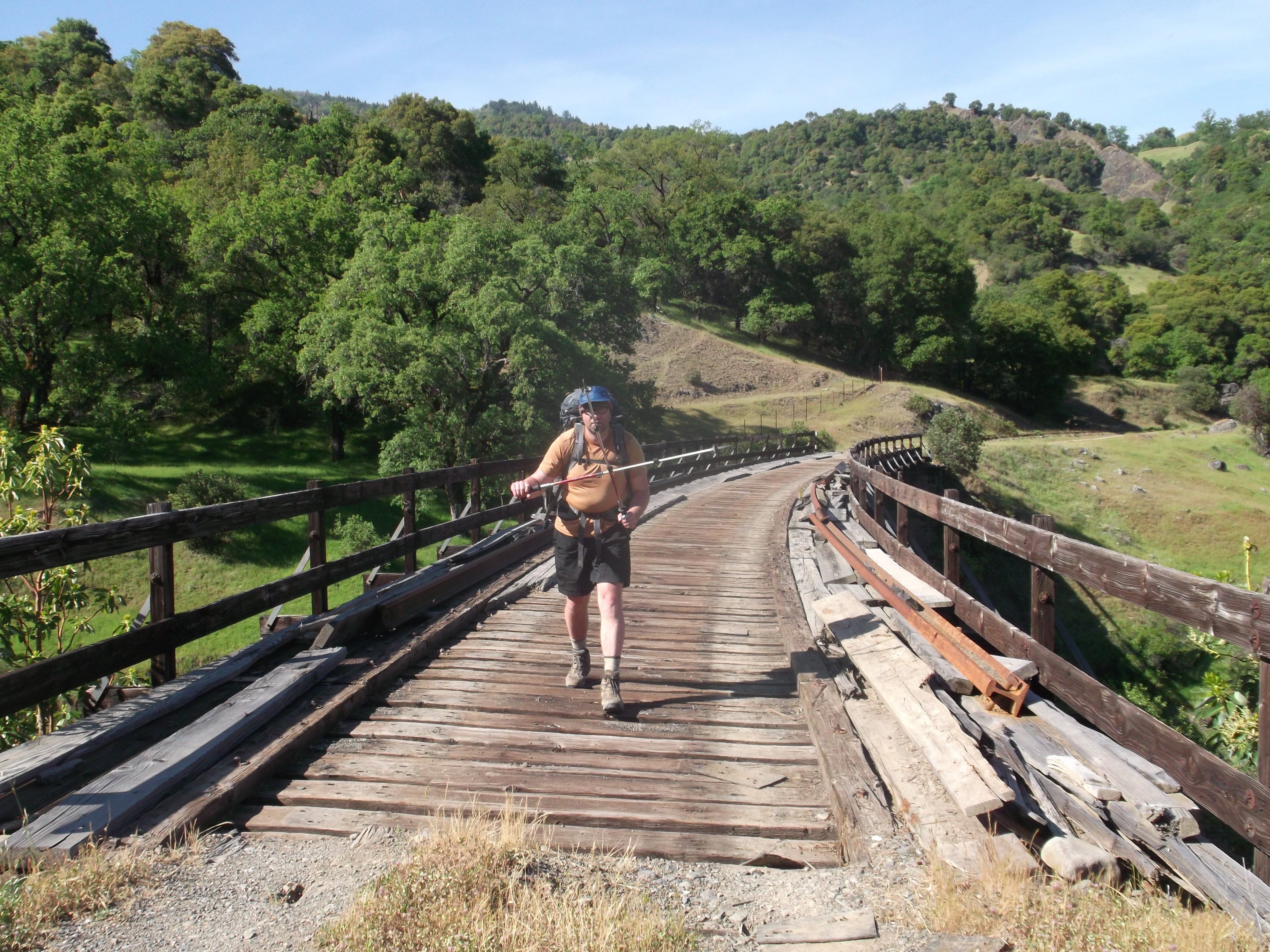 Chalk wards off vampires, locals, and most of all trolls, as he crosses the Bell Springs Creek Bridge. (photo by D. Speredelozzi)