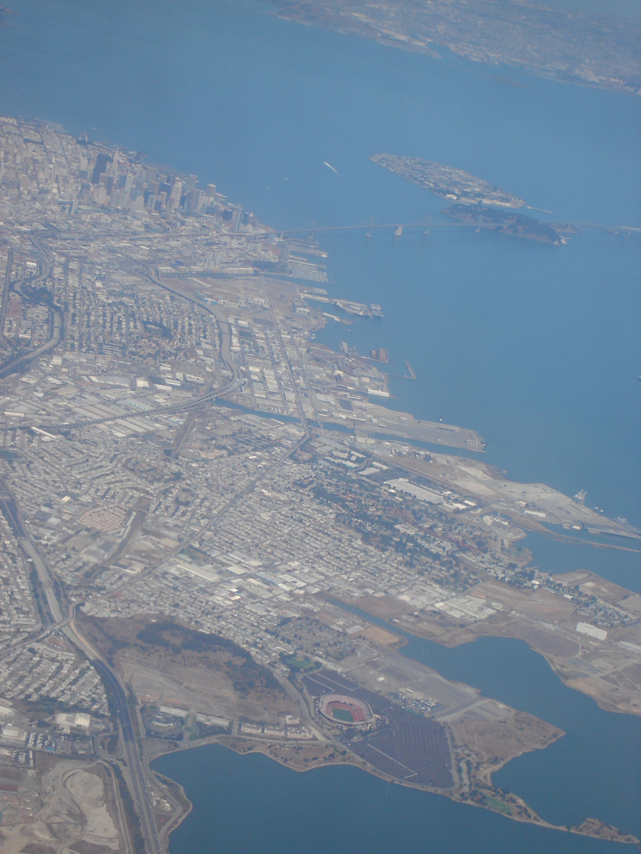 San Francisco, with Bayview-Hunters Point in the middleground, and Candlestick Park at the bottom of the frame. (photo by Wikimedia Commons)