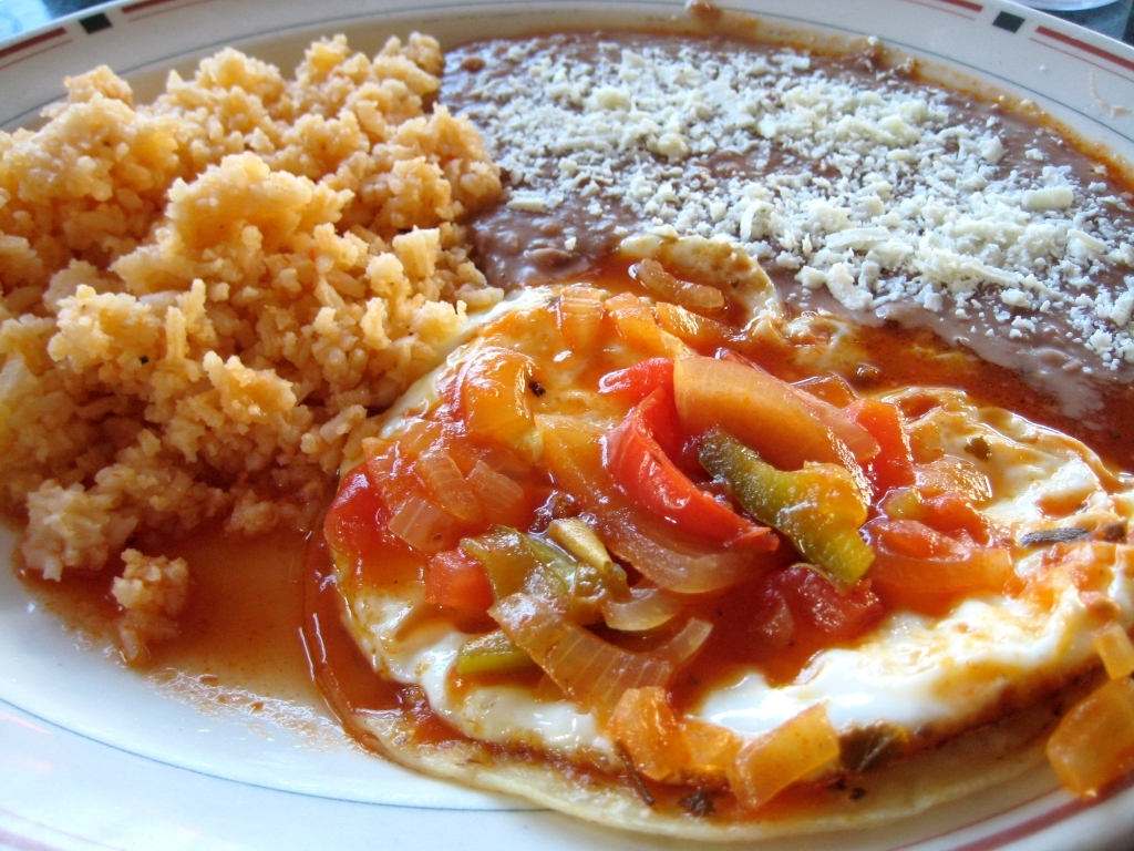 Huevos Rancheros, the official breakfast of Mexico. (photo by Elchavobeer, licensed by WikimediaCommons)