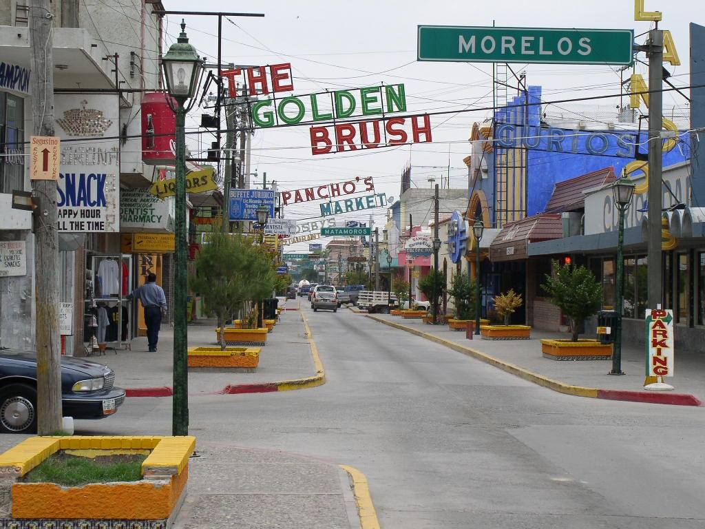 "In Mexican border towns like Ciudad Acuña, there is no daytime, per se. There's just that time of night time when the sun is out, the neon lights are resting, the hookers are all asleep, and the coke dealers are all off re-upping. But it's not ""daytime"". (image by brandon.multics.org)"